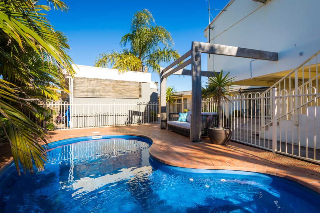 Relax by the pool Seashels Apartments Merimbula