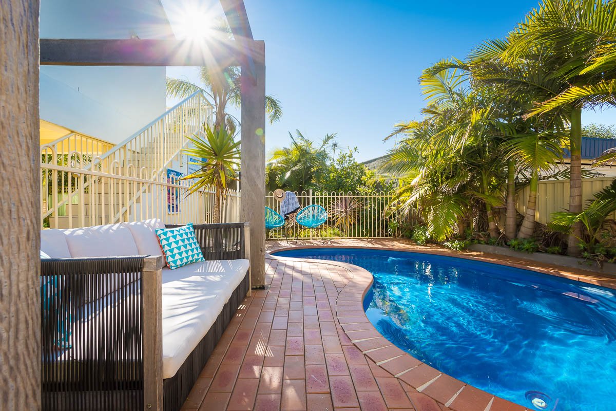Relax by the pool at Seashells Apartments Merimbula